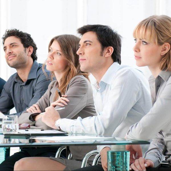 Business group of people attending and listening at conference